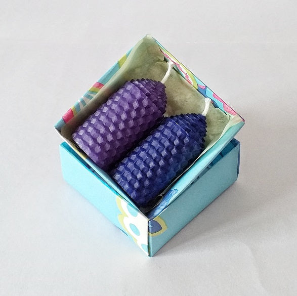 Purple and blue handmade pure beeswax candles in a giftbox