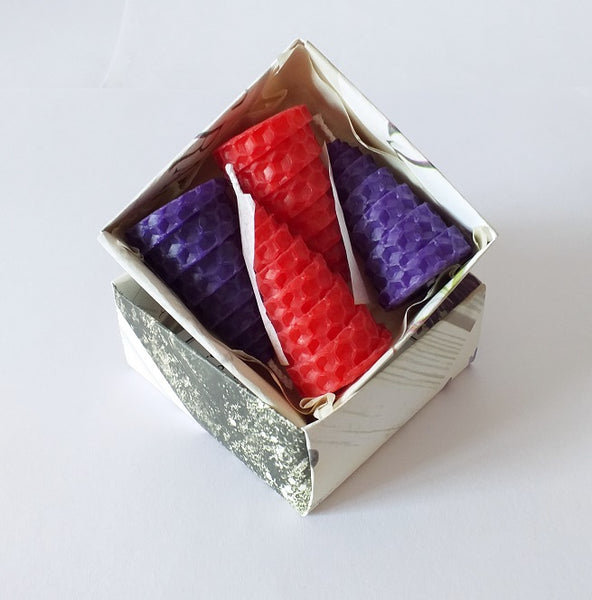 Red and purple beeswax candles giftboxed