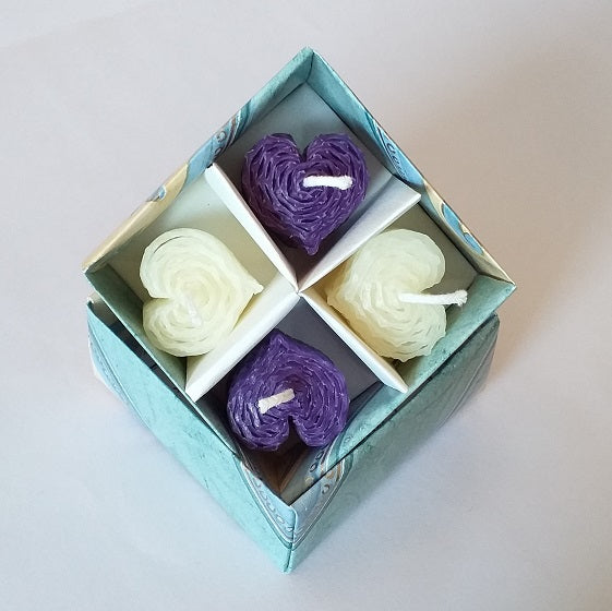 Purple and white heartshaped beeswax candles