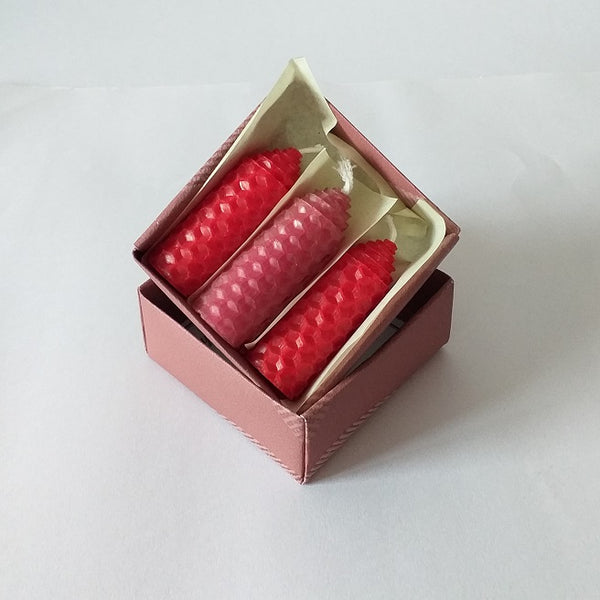 Three handmade red and pink beeswax candles giftboxed
