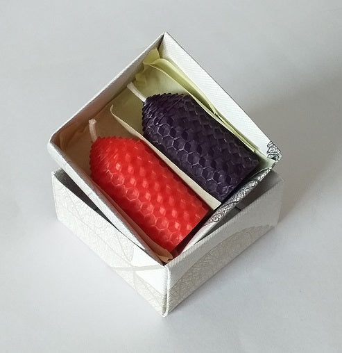 Red and purple handmade beeswax candles giftboxed