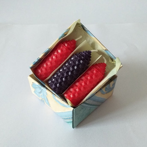 Three handmade red and purple beeswax candles giftboxed