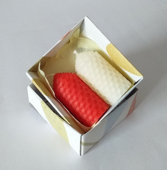 Red and white handmade beeswax candles giftboxed