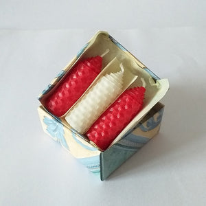 Three handmade red and white beeswax candles giftboxed