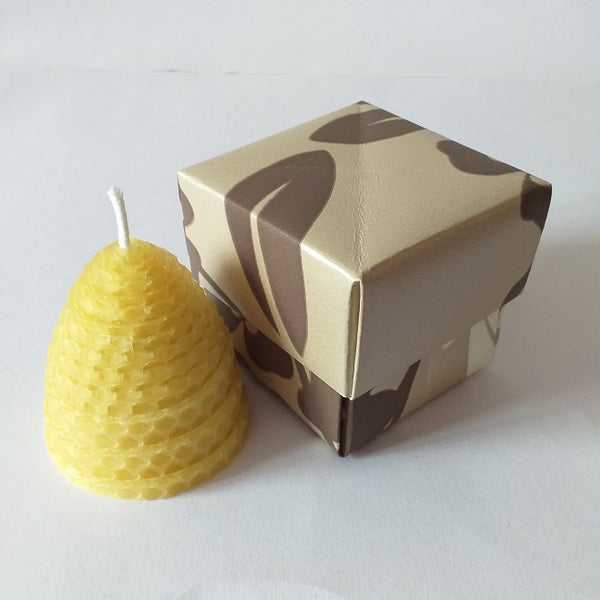 Small natural beehive pure beeswax candle in giftbox