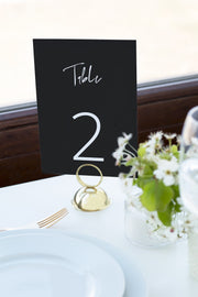 Priya - Black Contemporary Wedding Table Number Template - Unmeasured Events