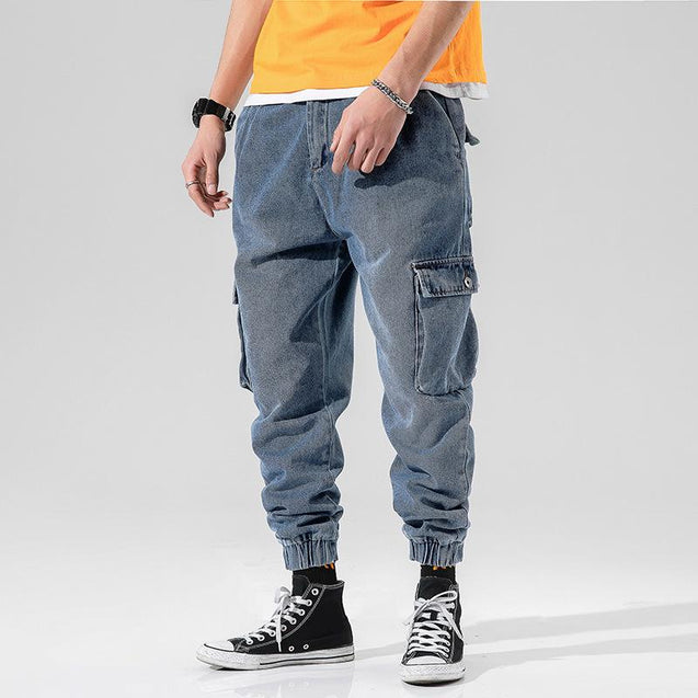 Loose beamed multi-pocket tooling jeans