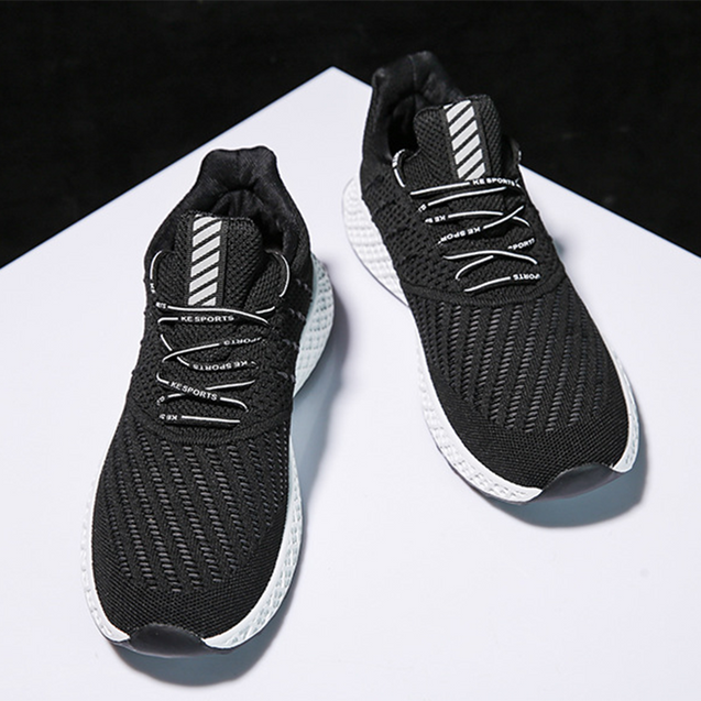 Men's trend solid color flying fabric breathable sneakers