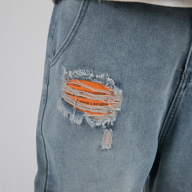 Fashion deliberately made old hole men's jeans