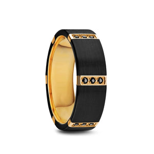 10 mm black titanium ring with a gold plated interior with triple black diamond settings on 6 gold plates