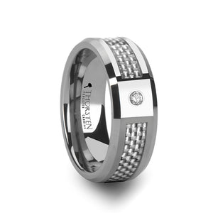 tungsten carbide ring with a white carbon fiber and a diamond inlay