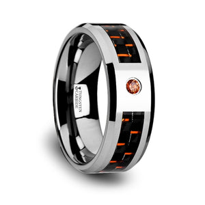 10 mm tungsten ring with a black and orange carbon fiber inlay and an orange padparadscha setting