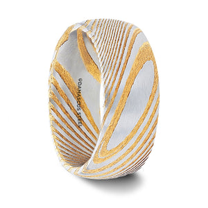 gold damascus steel wedding band with a vivid etched design