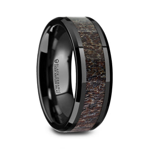 black ceramic ring with a dark brown antler inlay and polished beveled edges
