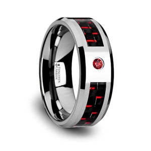 tungsten carbide ring with a black and red carbon fiber inlay and a red sapphire setting