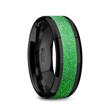 black ceramic ring with a bright green sparkling inlay