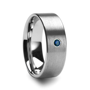 brushed tungsten wedding band with a blue diamond setting