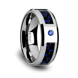 tungsten ring with a black and blue carbon fiber inlay, a blue sapphire setting and beveled edges