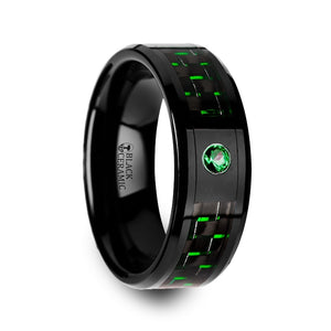 8 mm black ceramic ring with a black and green carbon fiber inlay and a green emerald