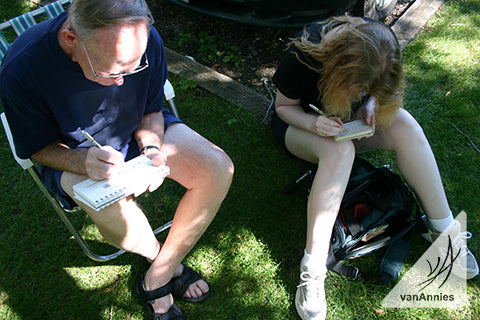 The artist and her father sketching outdoors.