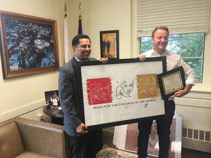 Jesse Raudales donates a signed Olympic Piece to the City of Annapolis, MD
