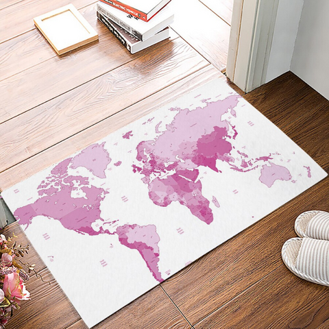 Tapis map monde rose.