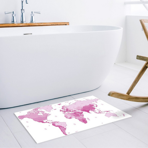 Tapis map monde rose et blanc.
