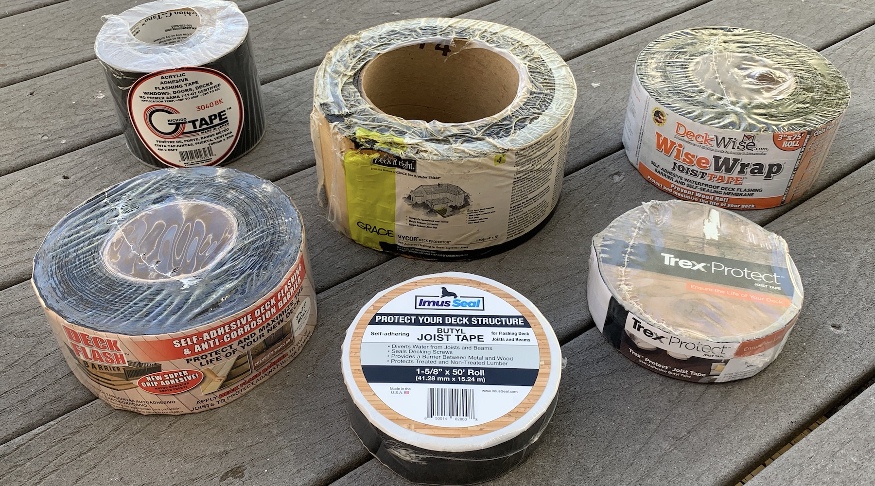 Joist and beam tapes for deck flashing including Imus Seal Butyl Joist Tape, Trex Protect, Nichigo G-Tape 3040BK, DeckWise WiseWrap JoistTape, Cofair Products Deck Flash Barrier, and Grace Vycor Deck Protector