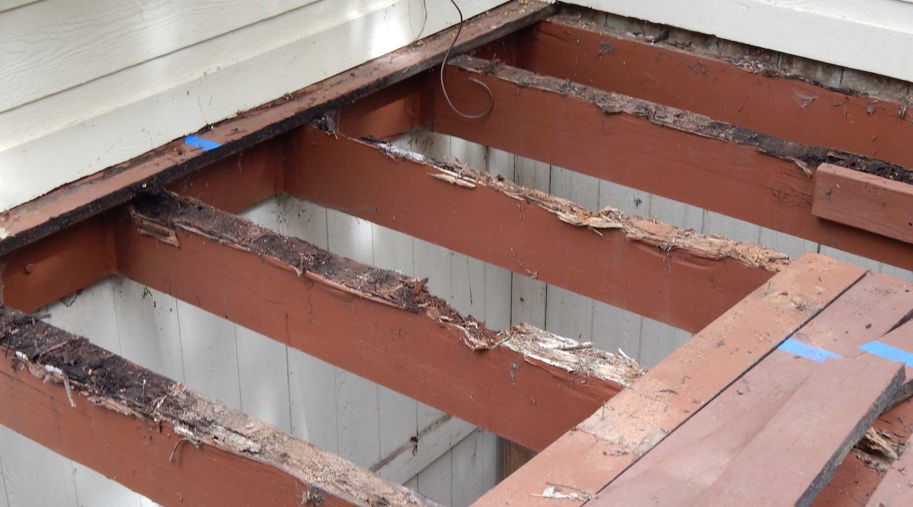 Rot on wooden deck joists and beams