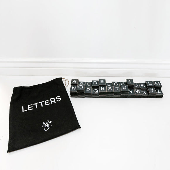Black Wood Tiles with White Letters