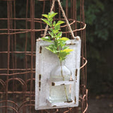Hanging Bottle Vase on Sheet Metal