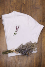 Load image into Gallery viewer, Wihte t-shirt with lavender embroidery on wood background and lavender plant