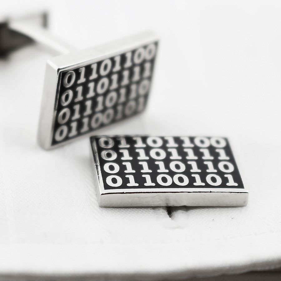Binary code cufflinks black background