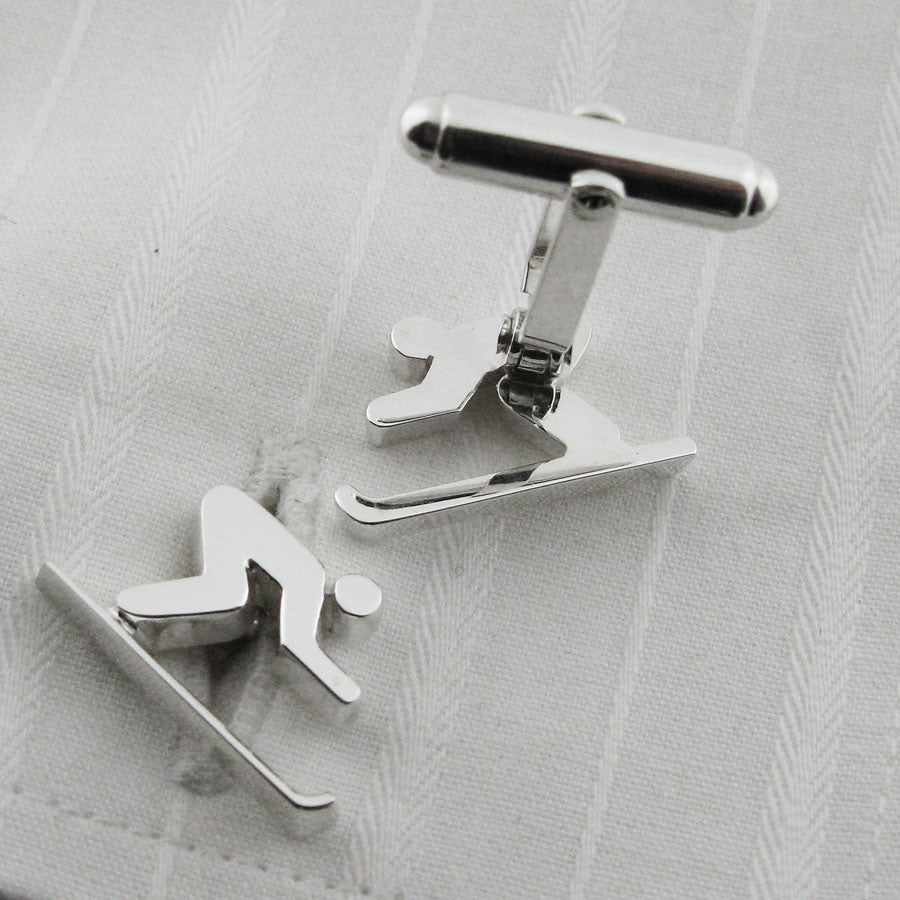 silver skiing cufflinks showing backs