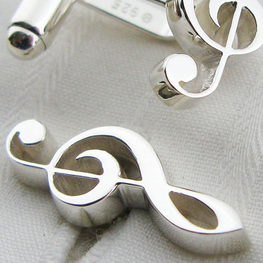 close-up of treble clef cufflinks