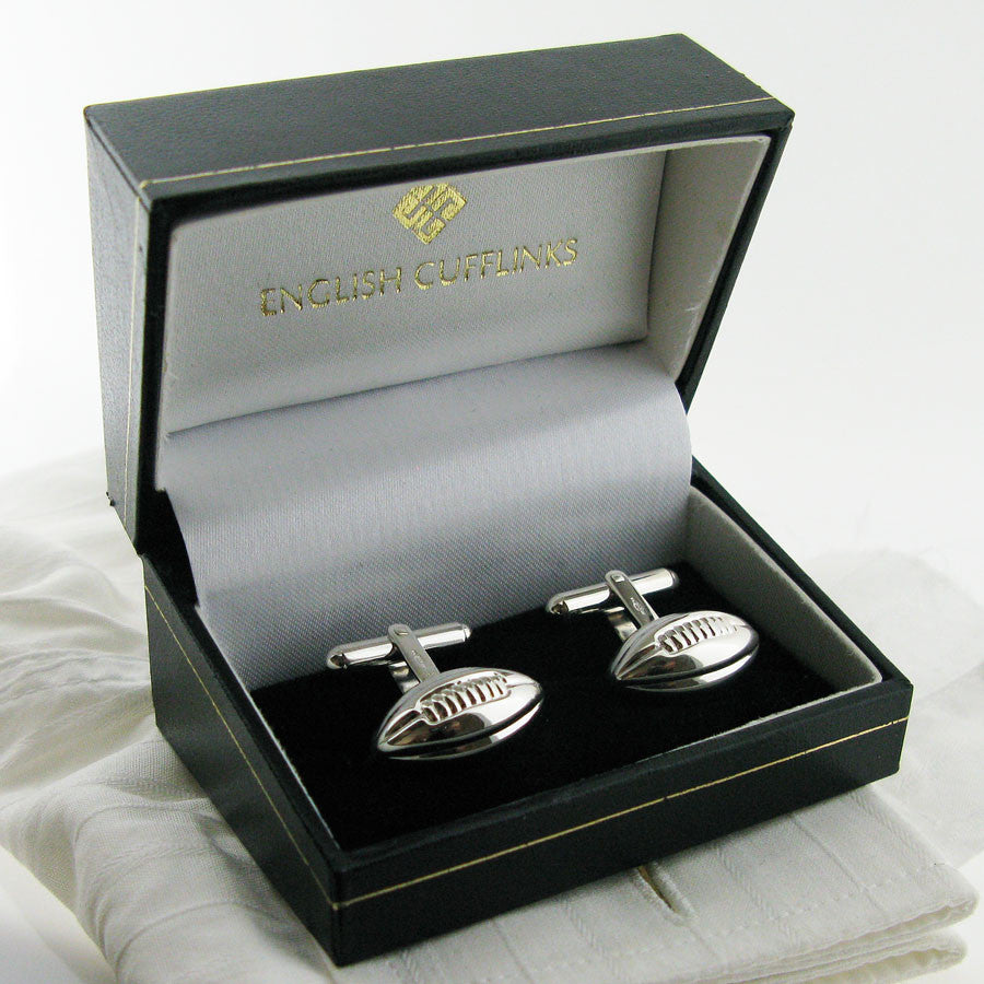 Silver rugby ball cufflinks in case