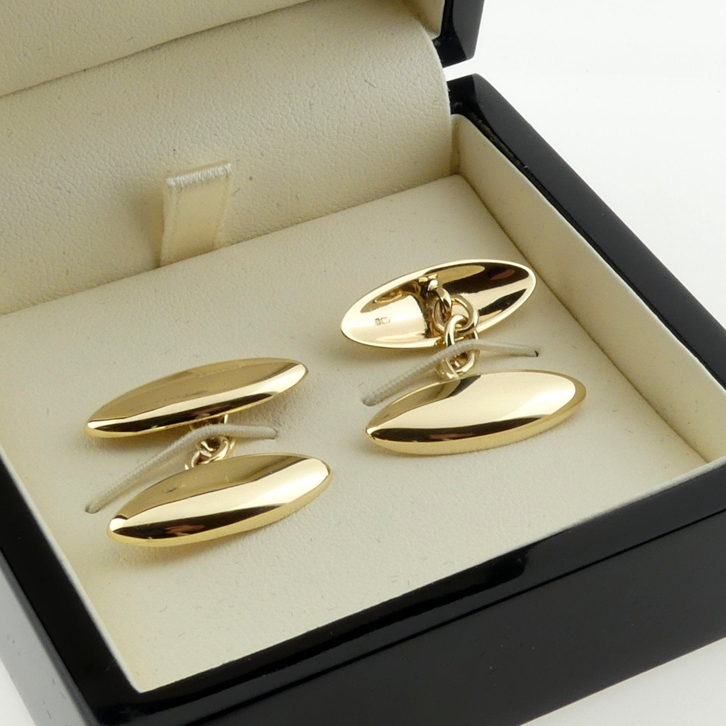 long domed oval gold cufflinks showing the back