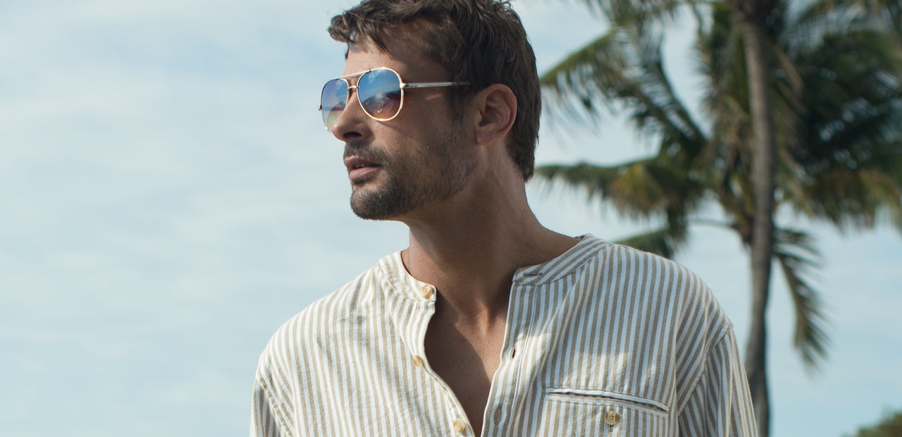Castaway brand shirt in indigo ink being worn by stylish man in sunglasses