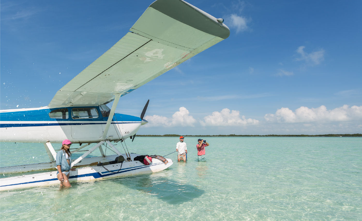 Seaplane floatign in shallow water off the coast of the Keys