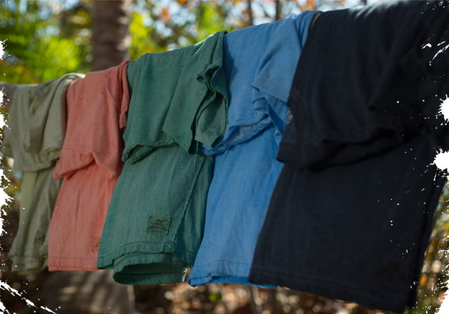 Oil washed Tees hanging on a rack