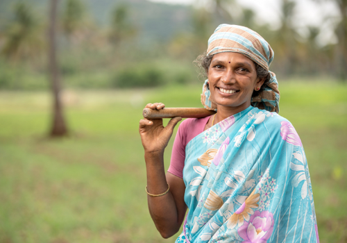 one of our women farmers in bihar, india smiling for the camera