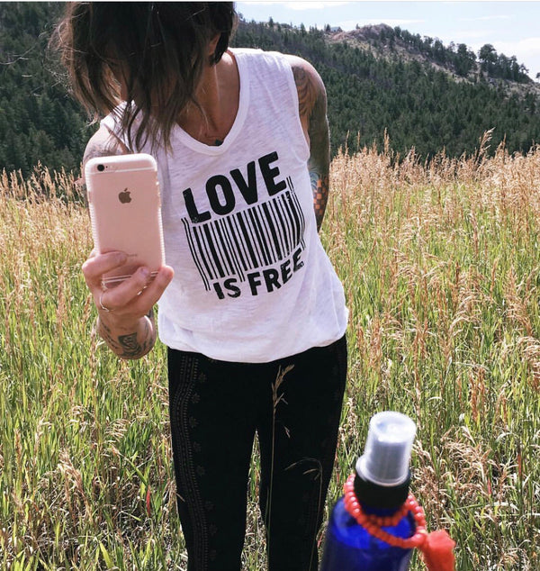 LOVE IS FREE  -  White 100% Cotton Muscle Tee