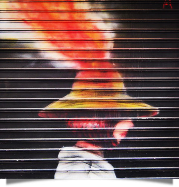 street art of a volcano in a hat reminds me of the mind-blowing alternative facts meme