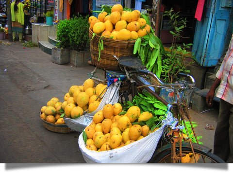 The mango is popular throughout South Asia, and here in a marketplace in Guntur India.