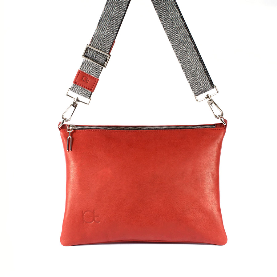 Leather Bag Sella color rubino  handmade with an elastic shoulder strap