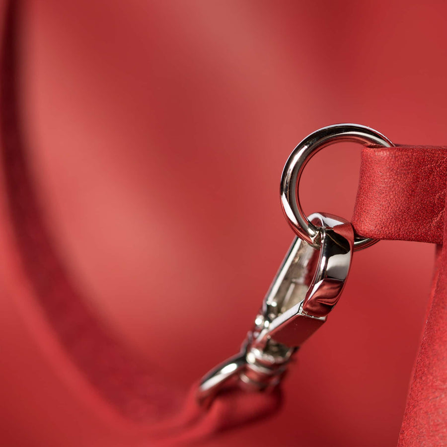 Detail Leather Bag Sacca color red handmade with an elastic shoulder strap