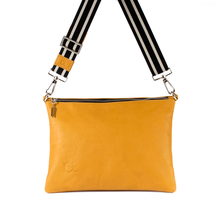 Leather Bag Sella color topazio handmade with an elastic shoulder strap