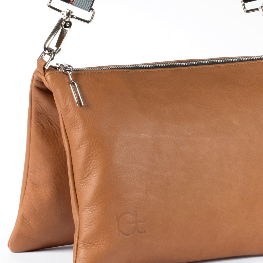 detail leather bag Sella color cognac  handmade with an elastic shoulder strap
