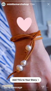 her pearls as a bracelet