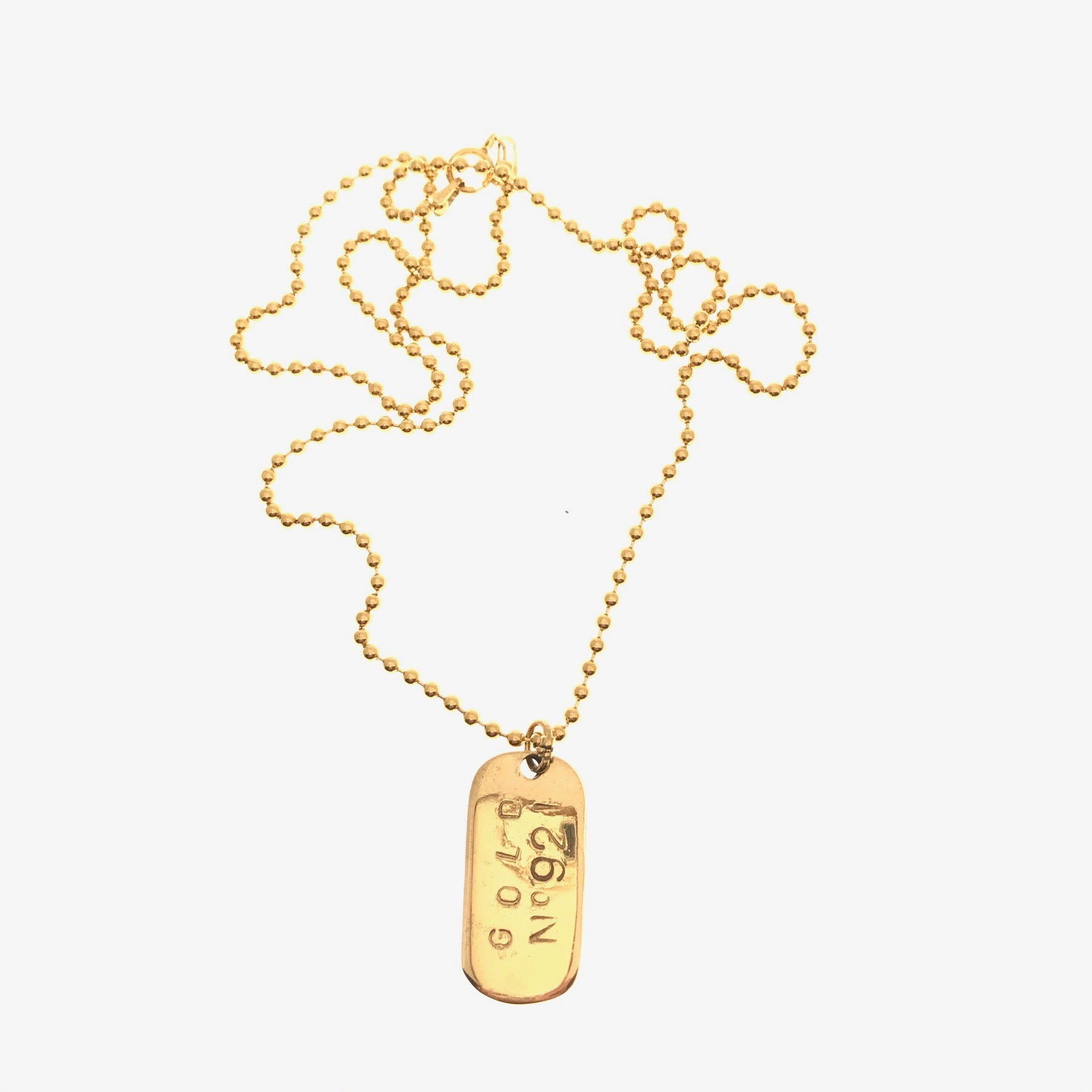 gold Chanel tag